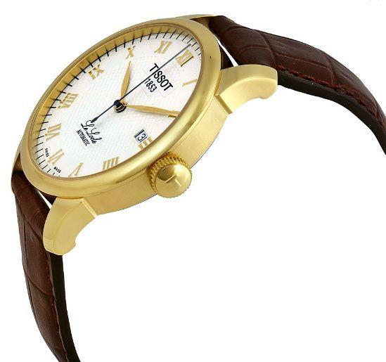 Núm của đồng hồ được khắc nổi chữ T rõ ràng, sắc nét
