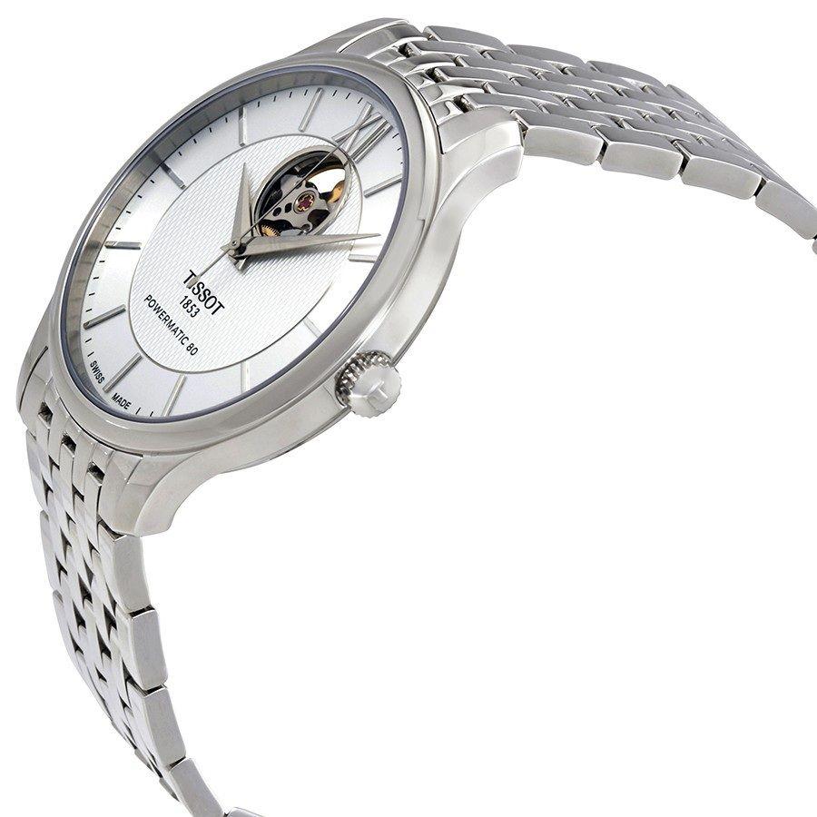Case đồng hồ khá mảnh chỉ 9.4mm được mạ bạc sáng bóng lịch lãm